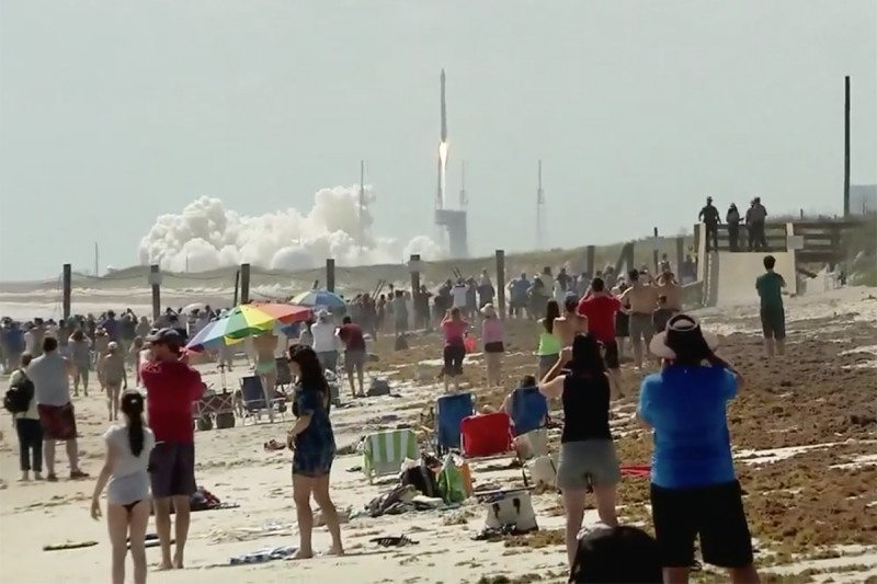 Crowd watches rocket launch at Cape Canaveral