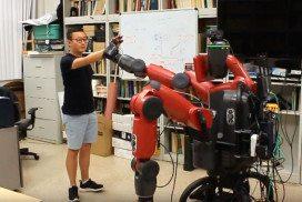 Robot high-fiving man