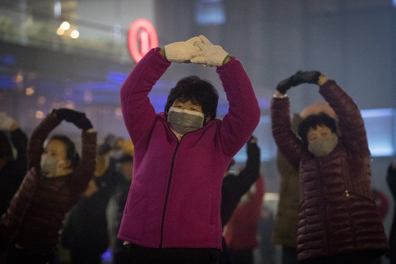 Some city-dwellers have taken to wearing gas masks to protect themselves from air pollution