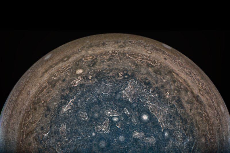 Jupiter's south pole showing swirly storms