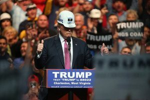 President Trump wearing a hard hat while giving a speech