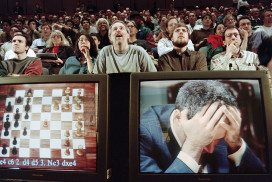 Kasparov with his head in his hands