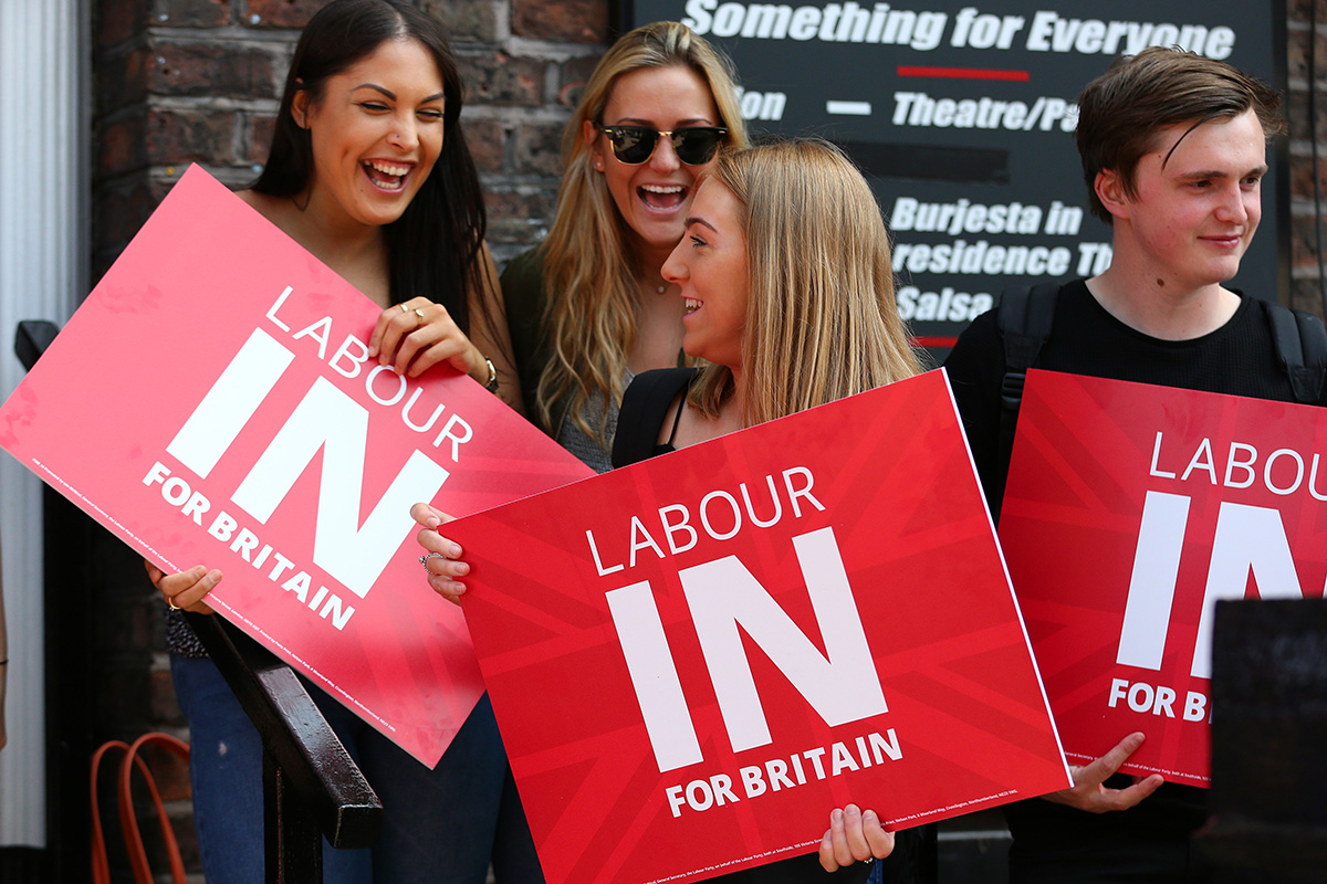 Supporters wait to greet Labour Party leader Jeremy Corbyn as he arrives at a student voter rally at on 13 May 2016 in Liverpool, England