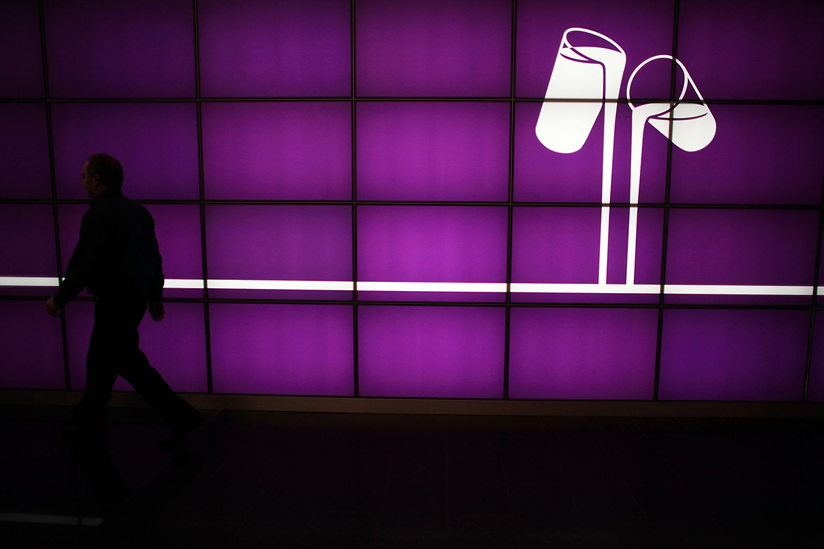 Man walking past Cadbury logo