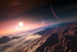 A possible view on an alien world: mountaintops poking through mist and two suns visible in the sky