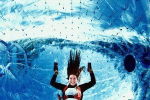 Woman inside inflatable plastic ball