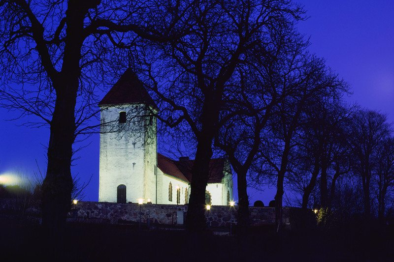Floodlit church against a midnight blue sky