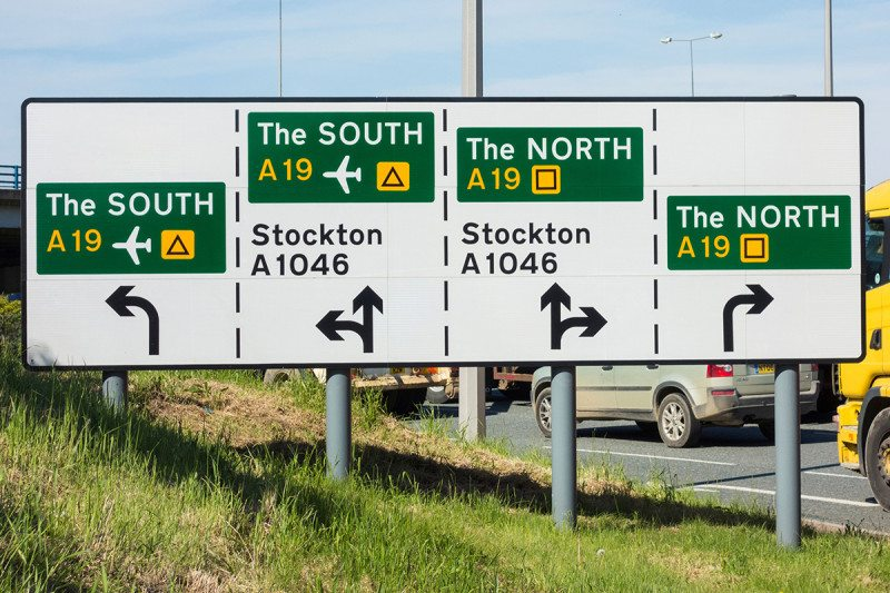 A road sign showing the directions to the north and south