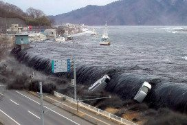 Cars being carried on the back of a tsunami