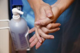 A woman washing her hands with handwash