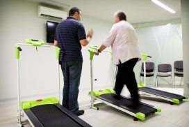 An overweight person on a treadmill