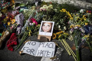 """A makeshift memorial that includes a photo of Heather Heyer, who was killed, at the site where on Saturday a car plowed into a group of counter-protesters after a """"Unite the Right"""" rally by white nationalist groups"""