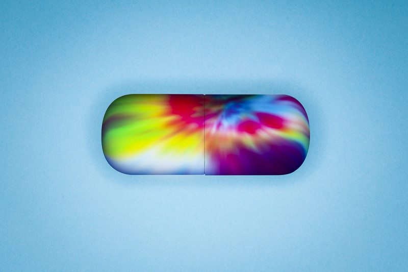 A multicoloured pill capsule