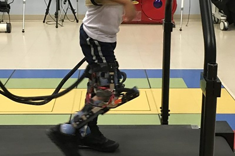 Child using exoskeleton legs