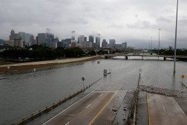The downtown Houston skyline and flooded highway 288 are seen August 27, 2017 as the city battles with tropical storm Harvey and resulting floods