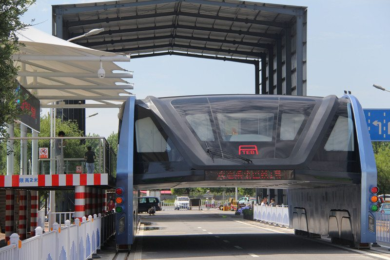 China's straddling bus operating on a stretch of road