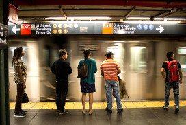 Commuters wait at NYC subway platform