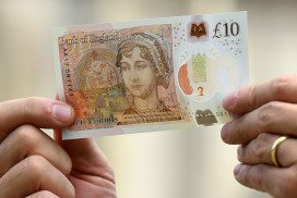 Hands holding new £10 banknote