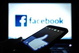 "Tablet displays Facebook ""like"" symbol"