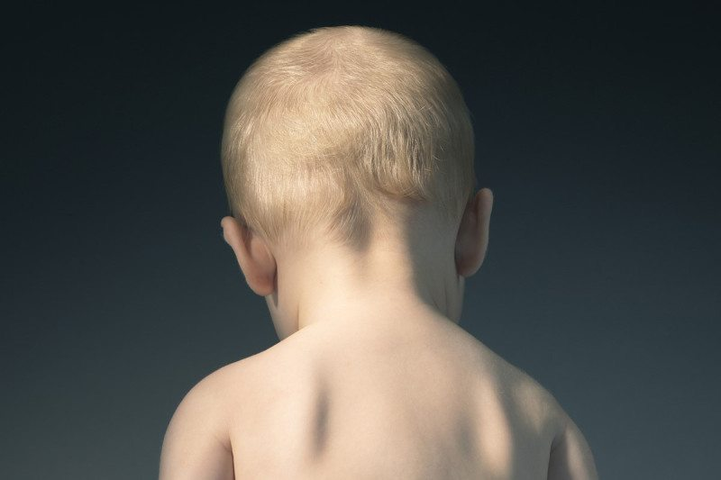 Back view of a baby's head and shoulders