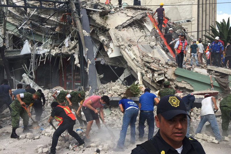 People search for survivors in a collapsed building in the Roma neighborhood of Mexico City