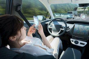 A woman in a driverless car
