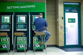 Man sits at betting machines