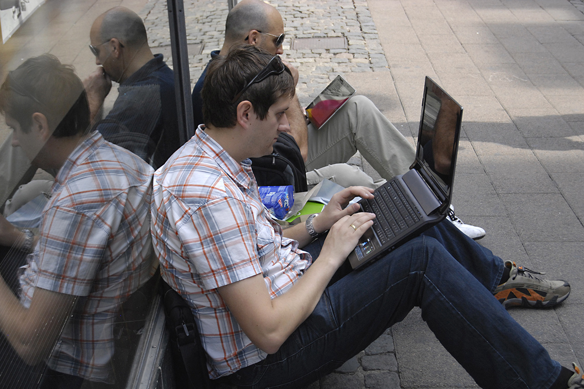 men sitting with laptops
