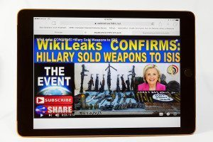 Computer screen showing video claiming that Hillary Clinton sold weapons to Isis