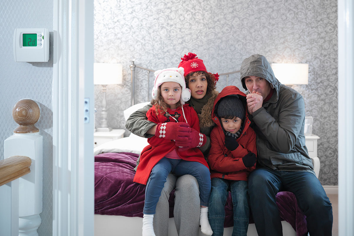 A family wrap up warm