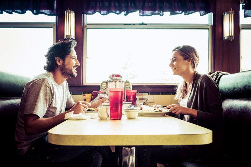man & woman in diner