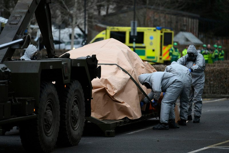 Military personnel in protective clothing removes vehicles from a car park in Salisbury, Britain, 11 March 2017