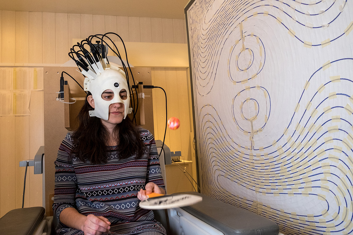 A person wearing a portable brain scanner