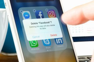 User deletes Facebook app from iPhone. The social media platform faces increased scrutiny around personal data privacy