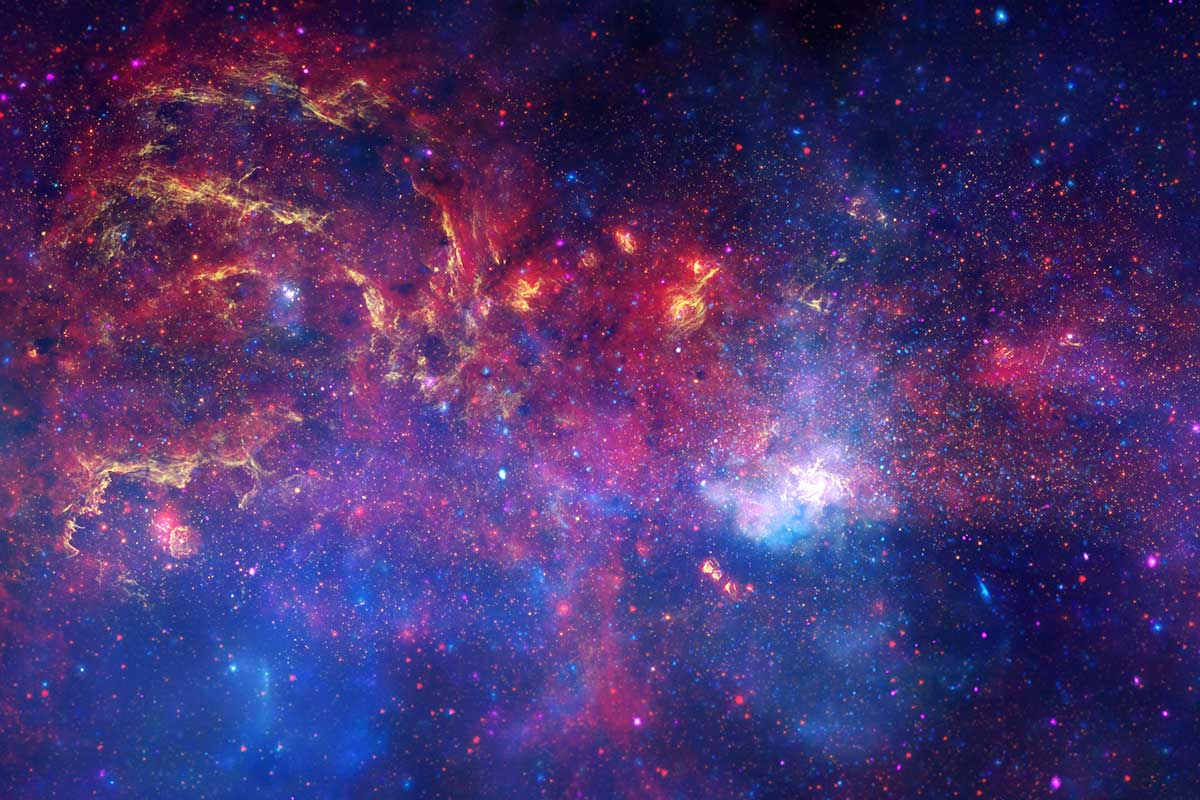 This image of the area around galactic centre is a composite of images taken in X-ray, optical, and infrared wavelengths