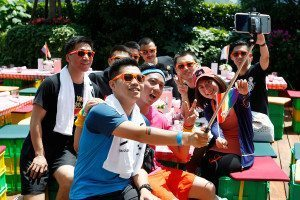 A group of young people in Shanghai holding a rainbow flag take a selfie