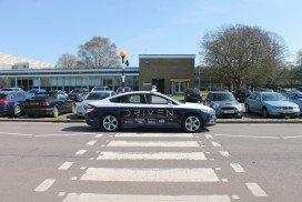 DRIVEN's driverless car drives past a pedestrian crossing