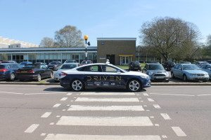 DRIVEN's driverless car drives past a pedestrian crossing