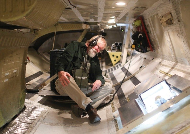 Geoscientist David Gallaher examines instruments in the cargo hold