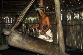 A Bora chief with a pair of traditional drums