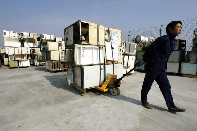man moving fridges