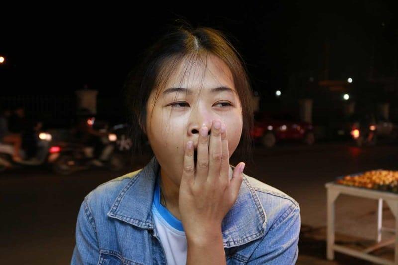 A woman yawning
