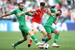 Players tustle for the ball during World Cup 2018's opening match between Saudi Arabia and Russia
