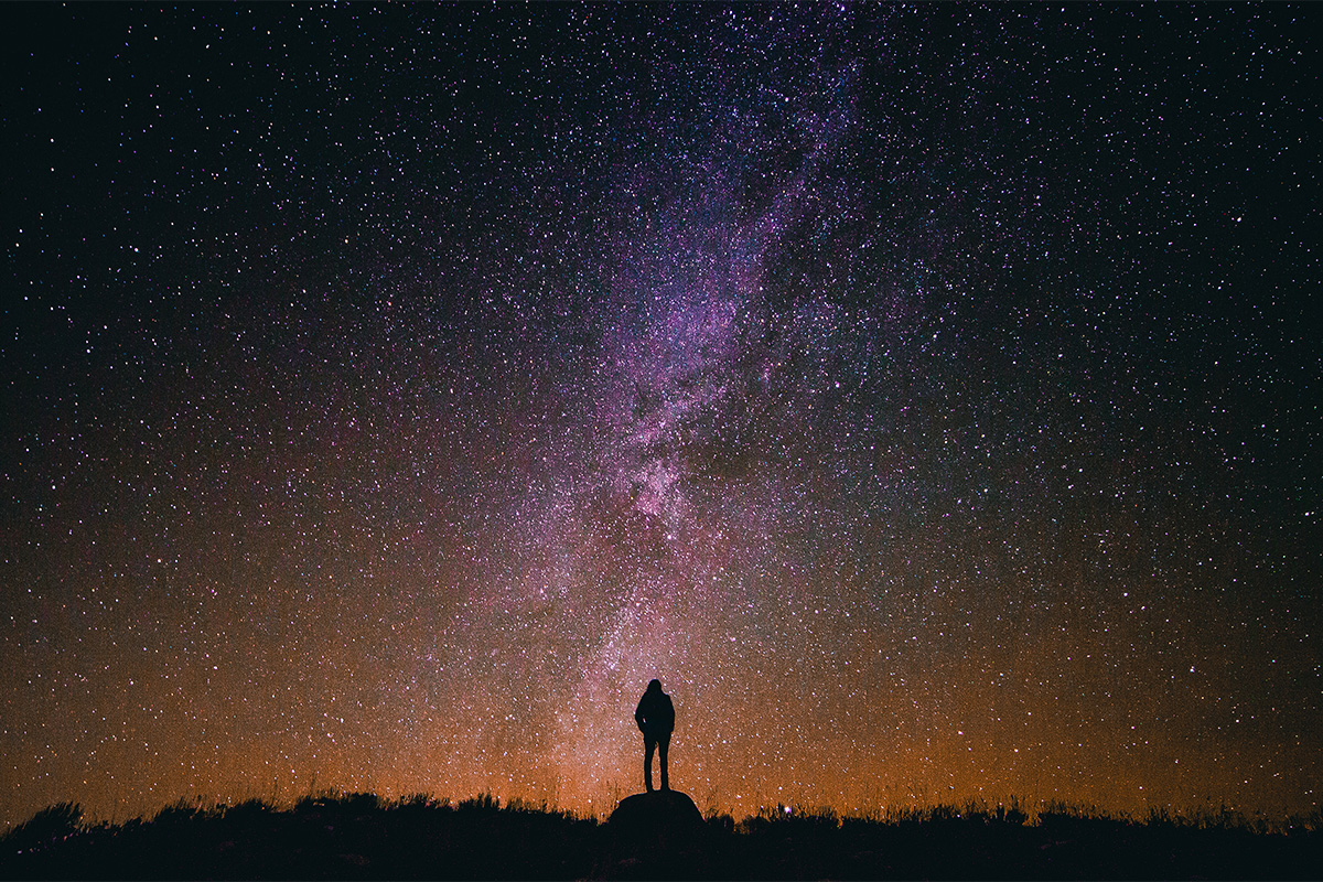Person stands beneath the Milky Way