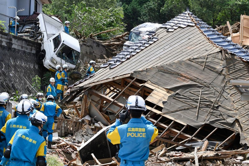 Rescuers prepare to start a search mission for missing person at the site of a landslide in Kumano town, Hiroshima prefecture