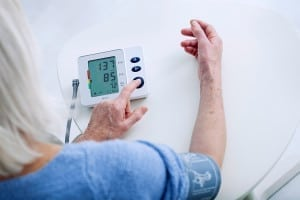 Someone measuring their blood pressure