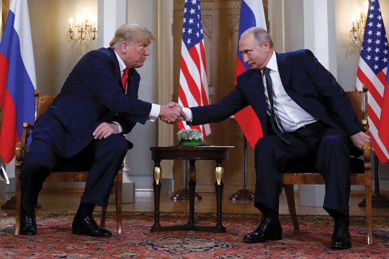 Donald Trump and Vladimir Putin shaking hands