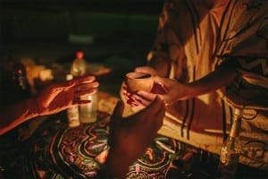 A man being handed ayahuasca