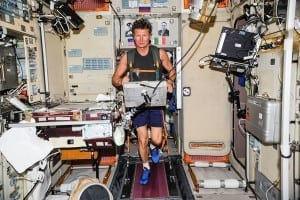 Astronaut on a treadmill on the ISS