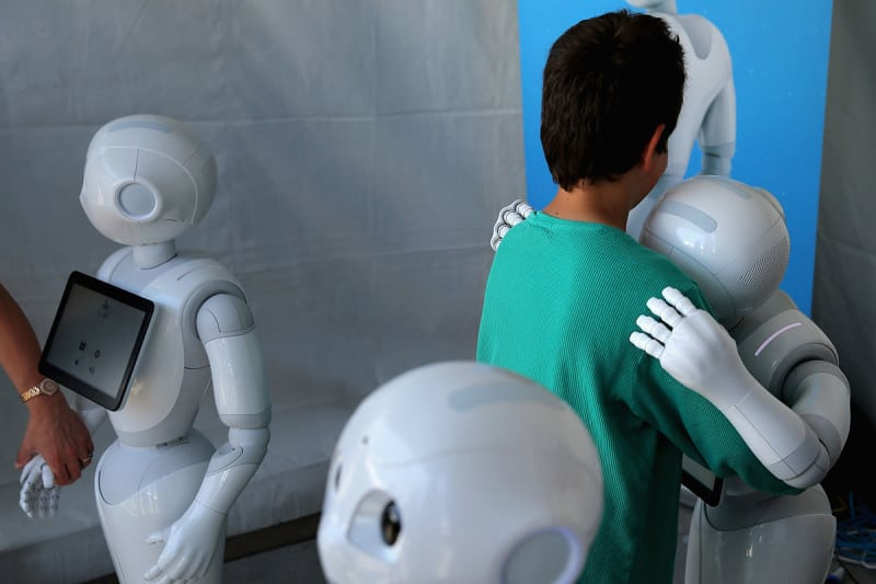 a robot hugs a person